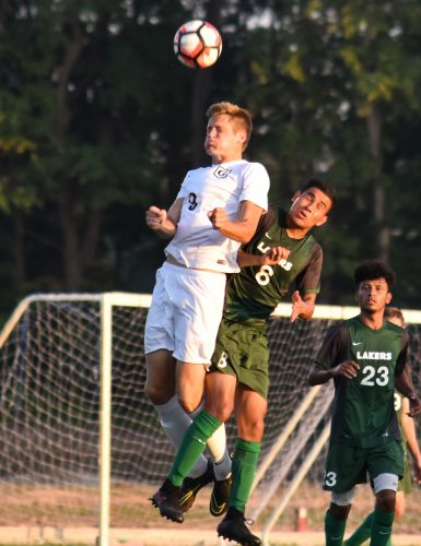 Grace College's Mitchell Zeilenga going up for a header against Roosevelt on Monday. (Photo by Chantel Shetler)