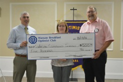 The Warsaw Breakfast Optimist Club donated $500 to Warsaw Community Schools. Pictured left to right are David Robertson, representing Warsaw Community Schools, and Jenny Lucht and Randy Polston representing The Warsaw Breakfast Optimist Club.