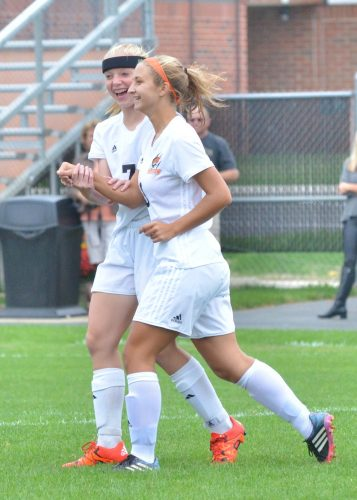 Delaney Taylor (7) celebrates with Julie Frazzetta after the game's first goal. (Photos by Nick Goralczyk)