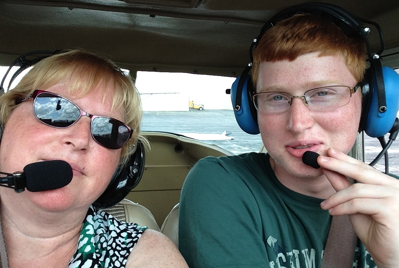 Deb Baumgartner, left, gets taken on a birthday flight with her son, Eric, as the pilot.