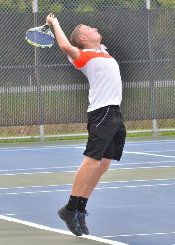 Hayden Steger winds up for his serve during Wednesday's opening rounds. (Photos by Nick Goralczyk)
