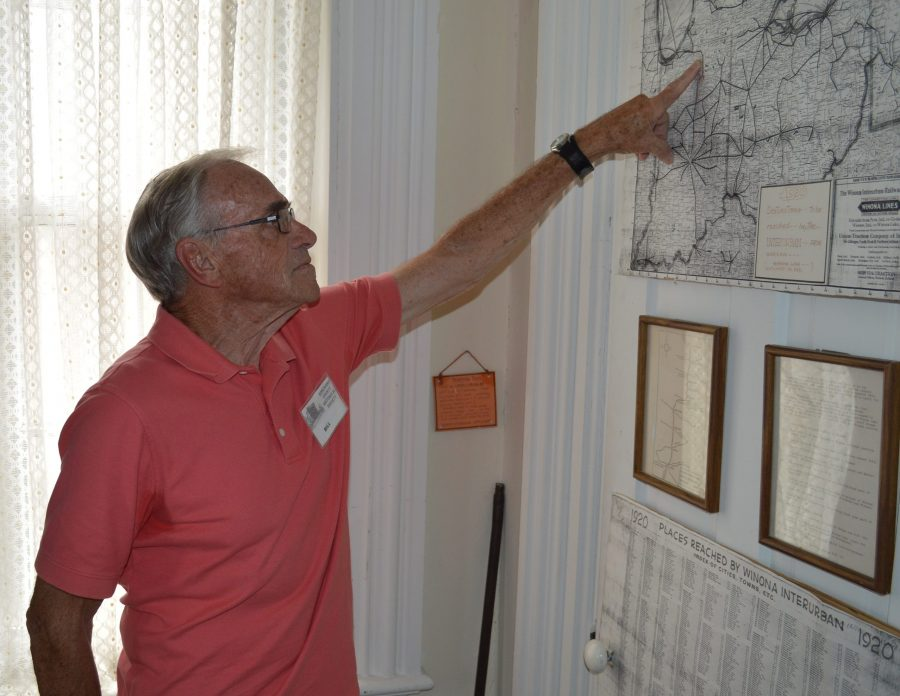 Probably Bill Huffer's favorite display room in the Old Jail Museum, Warsaw, is the transportation room. Here he is pointing out on a map part of Indiana's extensive interurban railway network. Huffer is a tour guide for the museum.