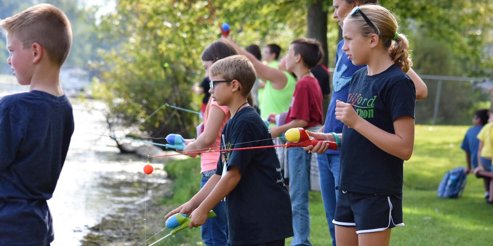 Fourth grade students from schools in Kosciusko County fish in Pike Lake as they learn about how to take care of local lakes and streams.