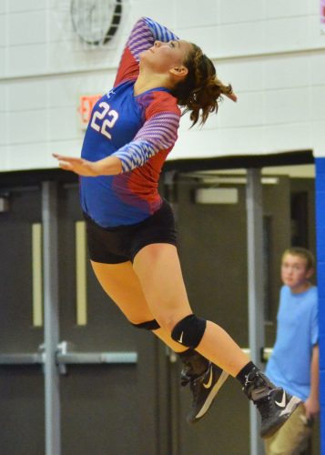 Kaity Reed goes up for a serve during Monday's win over Wawasee. (Photos by Nick Goralczyk)