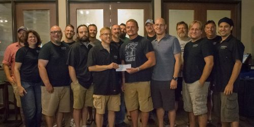 Pictured (from left to right) are Aaron Winey, Laura Watson, Buckley Watson, Rodney Wolfe, Jeremiah Stage, Brian Trainer, Jason Rich, Eric Jacko, John Stangland , CCS Executive Director Steve Possell, Nate White, Brian May, Bill Pietrzak, Jon Harding, Mike Gumz and Brian Kincaid. (Photo Provided)