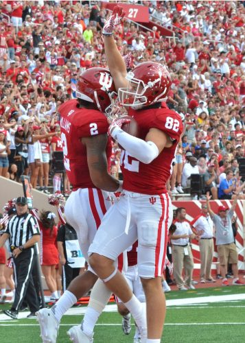 Devonte Williams (left) and Luke Timian (right) celebrate after Timian scored his first-career touchdown.