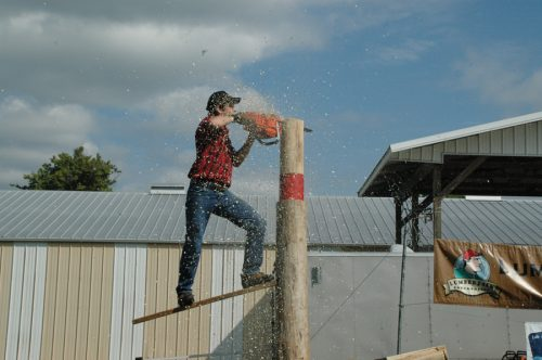 Professional lumberjack competitor Tim Knutsen wowed the crows with a cut performed on a springboard.