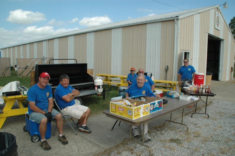 The North Webster Lions grilled hamburgers and hot dogs at the North Webster Fall Festival. From left are Derik Green, Dan Thystrup, Bob Richards, Scott Fox, Mark Lawson (in back), Greg Stump.