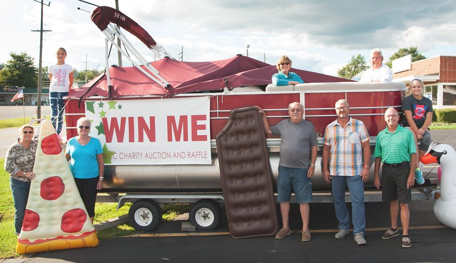 The pontoon is just one of the four grand prizes to choose from for the winner of the North Webster Community Center Heart of the Community Auction & Raffle. Some tickets are still on sale. In front, from left, Director of Operations Erin Smith, NWCC board members Janet Miller, Jon Sroufe, Todd Oesch and Dennis Wagoner. In back are Ali Smith, board members Lori Mark and Greg Schenkel and Abi Smith. The float props are courtesy of North Webster Ace Hardware.