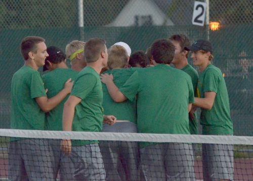 The Wawasee boys tennis team mob Dylan Staley after he clinched the team's first conference win of the season. (Photos by Nick Goralczyk)