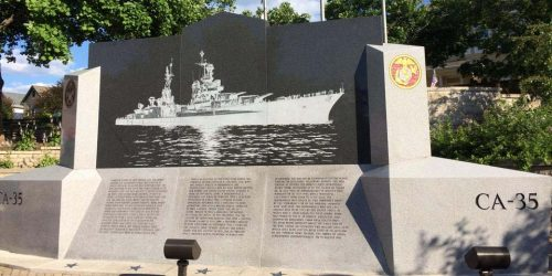 The memorial to the USS Indianapolis tells the history of the cruiser on one side and lists the names of crew members on the other. Photo by Brent Watts.