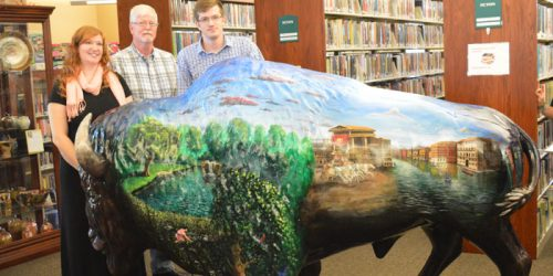 Shown are artists Kasha Iacob, Kerry Barrett and Trent Barrett with Wooly Webster, the new Bison at the North Webster Community Public Library. Wooly was unveiled at the start of the annual cemetery walk, held Sunday, Sept. 11