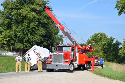 Crews work to move the truck out of the roadway.