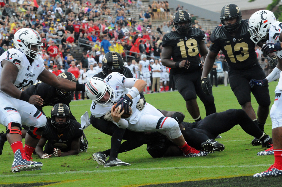 Cincinnati quarterback Hayden Moore dives into the endzone during the Bearcats' 38-20 win at Purdue Saturday afternoon. (Photo by Dave Deak)