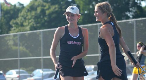Grace College's Mariah Lewis and Gabrielle Lawrence smile during their 8-1 win at No. 3 doubles against Manchester on Monday. (Photo provided by the Grace College Sports Information Department)