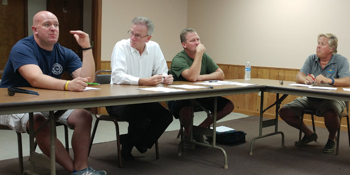 Chris Francis, township advisory board member, makes a statement during the Tippecanoe Township Advisory Board meeting Tuesday. Advisory board members Richard Owen and Steve Carson and township trustee Steve Ward are shown to the right.