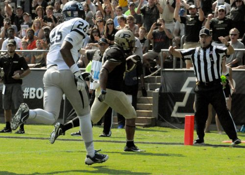 Markell Jones carries the ball into the endzone for Purdue.