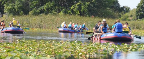 Seven rafts with groups of approximately eight took to the waters of Mudd Lake and Syracuse to learn about the watershed