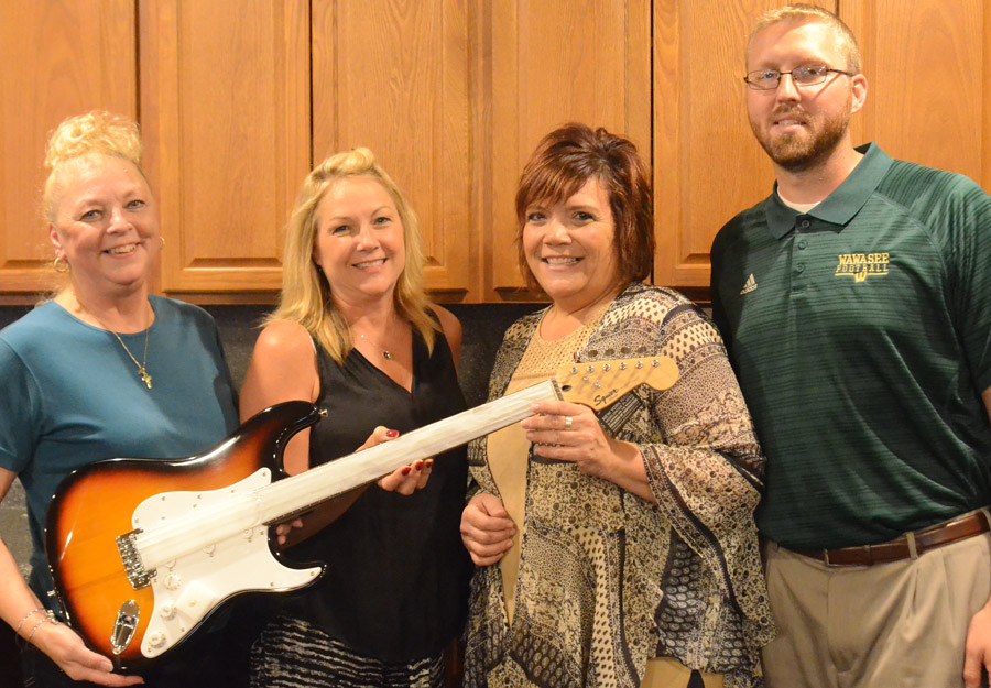 Rotary Rocktoberfest committee members Sylvia Gargett, Susan Stump, Tracey Sleighter and Eric Leffler are shown with the guitar which will be sold through a silent auction.