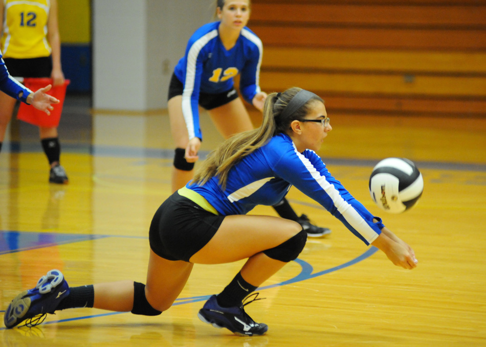 Tyana Spencer gets low to dig a Culver attempt Thursday evening. (Photos by Mike Deak)