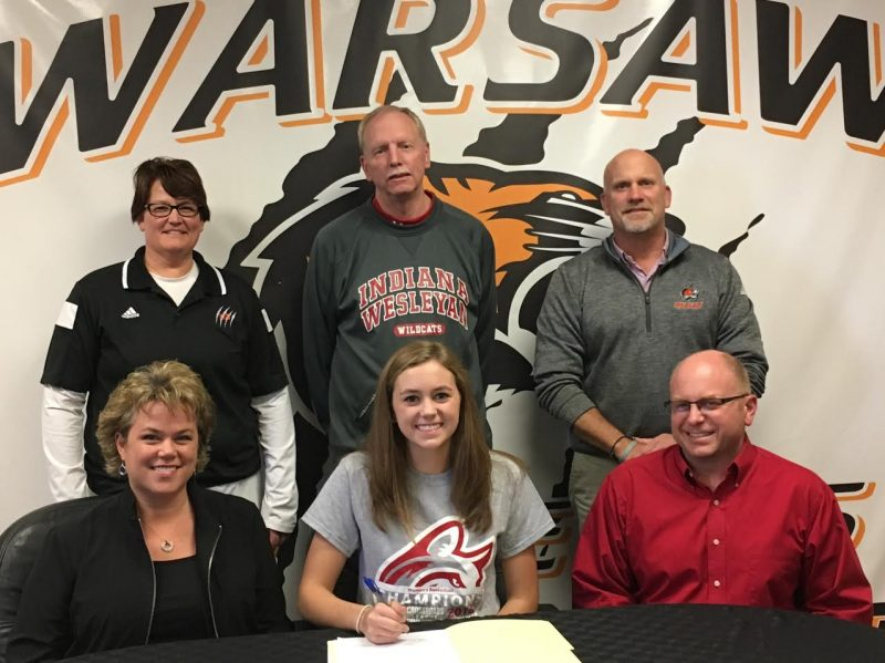 WCHS senior Dayton Groninger signs to continue her basketball career next year at Indiana Wesleyan University. Groninger is flanked by her parents Erika and Jason. In back are WCHS girls basketball coach Michelle Harter, IWU coach Steve Brooks and WCHS Athletic Director Dave Anson (Photo provided)
