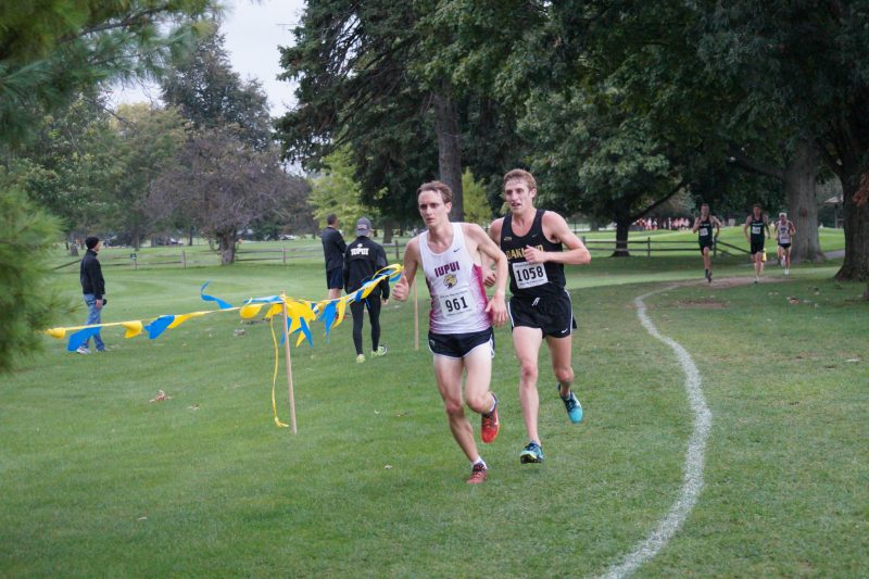 Former WCHS running standout Robert Murphy (at left) took first place honors in the Gold Race at Notre Dame. Murphy led his IUPUI team to a third-place finish.