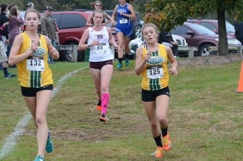 Bailey Schroeder (left) and Katie Haines run together for the Warriors.