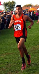 Warsaw's Francisco Ramirez (555) is in full flight coming down the homestretch.