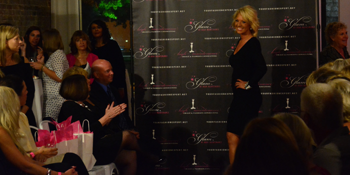 Glam owner Michelle Smith LeDrew models a dress in Glam's new fall and winter line.