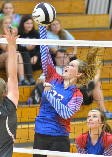 Lyndsey Sapp records a kill during Tuesday night's win over Fremont. (Photos by Nick Goralczyk)