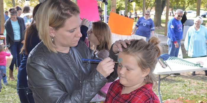 Syracuse Fall Harvest Festival will have several, fun activities for the entire family to enjoy. Face painting and games are part of the day's activities. Pictured is Rachel Kruger of Kruger Doodles painting the face of Rori Methe, 5, of Syracuse at last year's festival. (File photo)