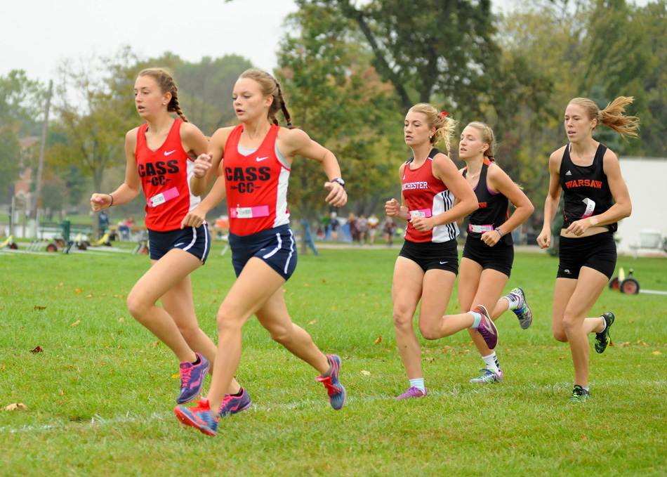 Warsaw's Mia Beckham and Allison Miller will look to stay near the front of the pack, as will Cass' Miah Martin and Alexis Jackson and Manchester's Rae Bedke at the IHSAA Cross Country State Finals. (File photo by Mike Deak)