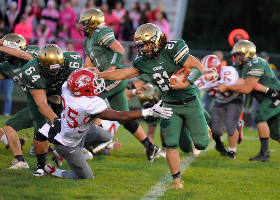 Wawasee's Noah Wadkins gets past the tackle attempt of Goshen's Rummel Johnson Friday night. (Photos by Mike Deak)
