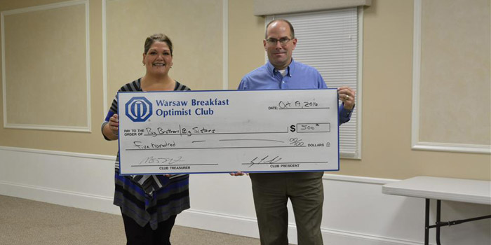 Pictured from left are Shelley Schwab, representing Big Brothers Big Sisters, and Bob Bishop representing The Warsaw Breakfast Optimist Club.