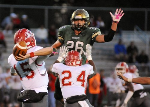 Wawasee's Paul Mendoza attempts to knock down a CJ Detweiler pass.