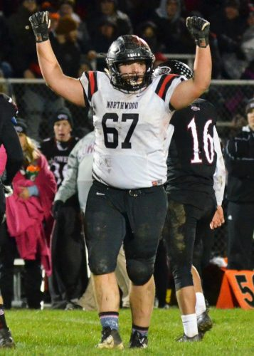 Andrew Miller pumps up the crowd after the Panther defense makes a stop during Friday's 21-14 semi-state victory over Lowell. (Photos by Nick Goralczyk)