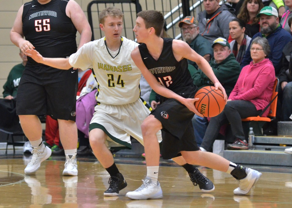 Cameron Schlabach (24) will be one of three seniors looking to lead Wawasee to a winning record in 2016-17. (File photo by Nick Goralczyk)
