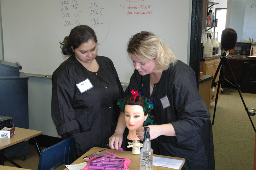 "Inspire Cosmetology School owner/educator, Nicole Lawrence, right, worked with Joni Aguilar of Warsaw on a perm. ""I see such potential in these students,"" Lawrence exclaimed. (Photo by David Hazledine)"