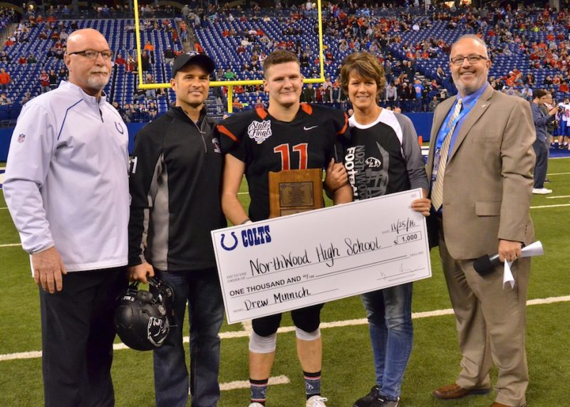 NorthWood's Drew Minnich (center) was named the Phil N. Eskew Mental Attitude award winner following the conclusion of Friday's state championship game. (Photos by Nick Goralczyk)