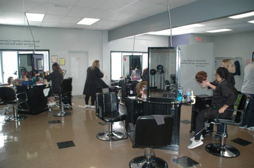 Some students, after earning 250 hours of classroom time, will work in the salon, where the community pays reduced prices for hair and nail services.