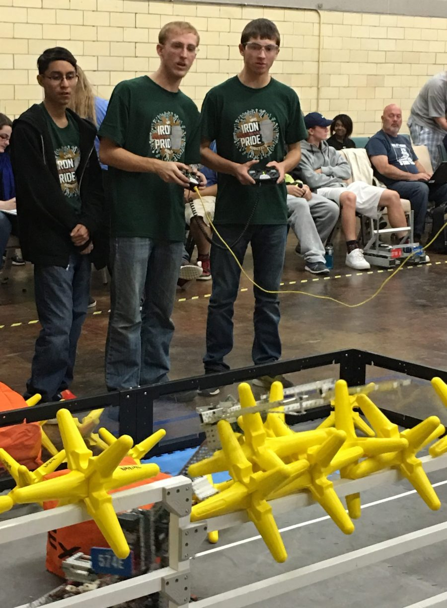 From left, Abdiel Sanchez, Cedric Church and Joe LeCount of Team Immortal are driving their robot during a recent match in Indianapolis.