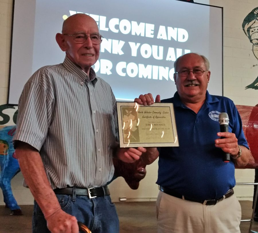 Jerry Rhodes, left, was chosen as the very first North Webster Community Center Volunteer of the Year. Jon Sroufe presented the award at the auction.