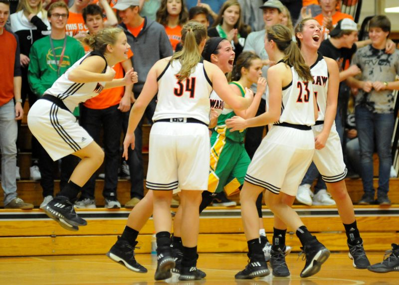 Page Desenberg, center, celebrates with her teammates after hitting a buzzer-beater during a 66-42 win over Tippecanoe Valley in girls basketball Friday night. (Photos by Mike Deak)