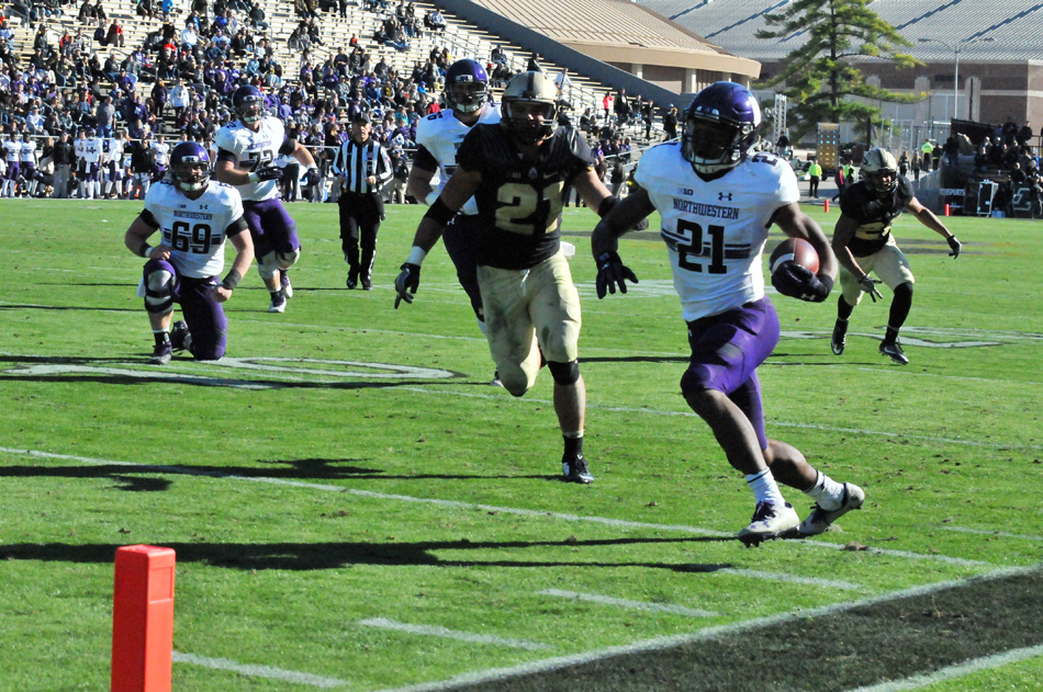 Northwestern's Justin Jackson runs in from 19 yards for a touchdown as part of Northwestern's 45-17 win at Purdue Saturday afternoon. (Photos by Dave Deak)