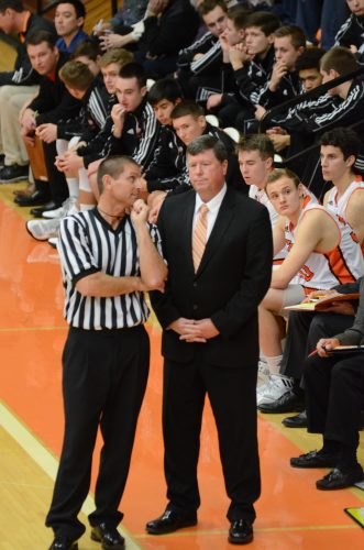 Warsaw coach Doug Ogle listens to an explanation from an official.