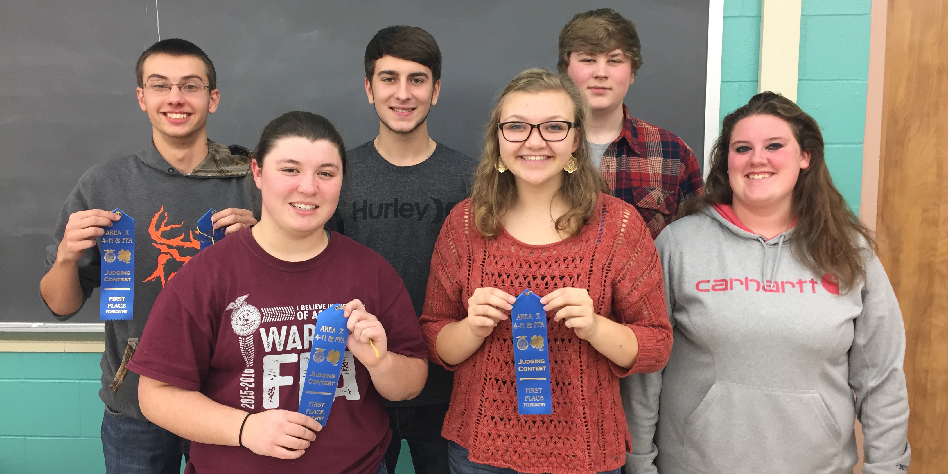 Warsaw FFA Forestry Judging Teams. In front, from left, are Taryn Whetstone, Morgan Smith and Sydney Fox. Back row are Zach Howard, Grant Reed and Jared Wolf.