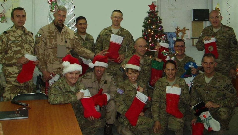 For the past three years Susan Manns has headed a stocking collection for soldiers deployed during Christmas as part of the Treasures for Troops organization. These stockings cost little to build and provide each of the nearly 450 soldiers which the organization helps a brief reminder from home during the holidays. Pictured are just one of the groups who received stockings last year.