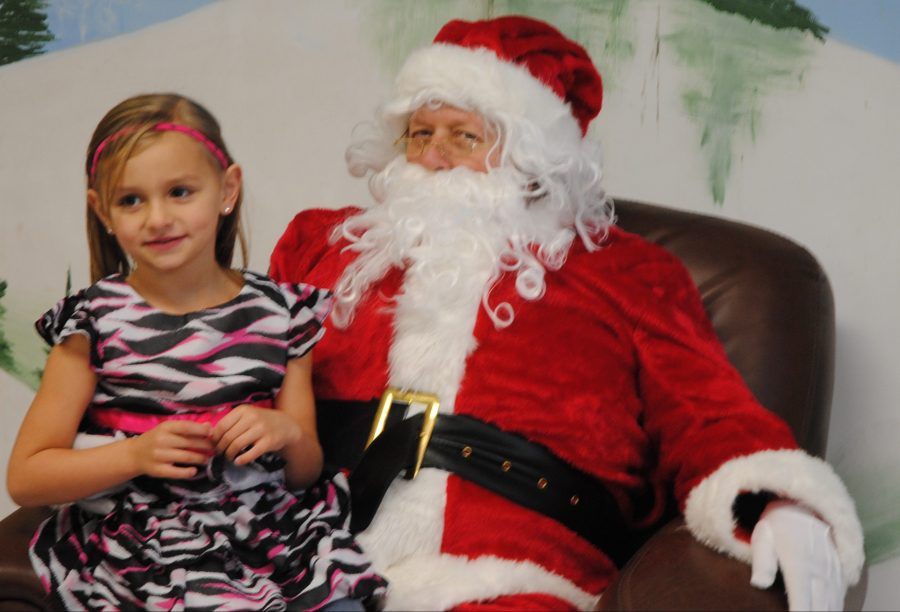 Amara McClure is shown with Santa Claus in 2015 in North Webster.