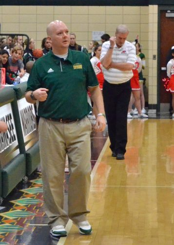 Wawasee JV coach Trent Beer (front) and Goshen JV coach Jack Beer (back) each pace the sideline during Friday's night's JV contest.