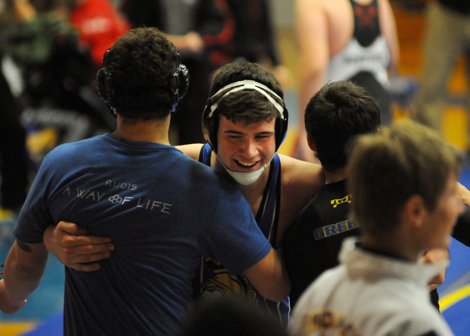 Triton's Bryson Seitner receives some love after scoring a pin against North Miami Tuesday night. (Photos by Mike Deak)